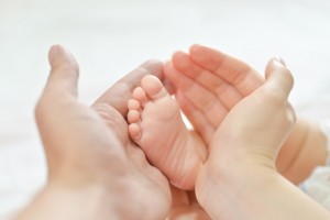 Baby feet in mother hands.
